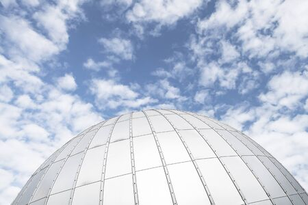 Shiny metallic observatory dome under cloudy blue sky, abstract background photo Standard-Bild
