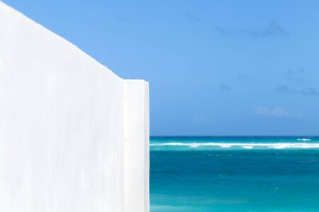 Abstract minimal architecture photo, blank white corner with bright sea water and blue sky on a background