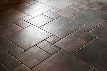 Shiny stone floor tiling, background photo with selective focus Banque d'images