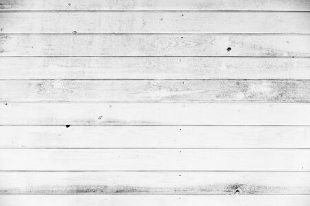 Grungy white wooden wall made of planks. Frontal flat background photo texture