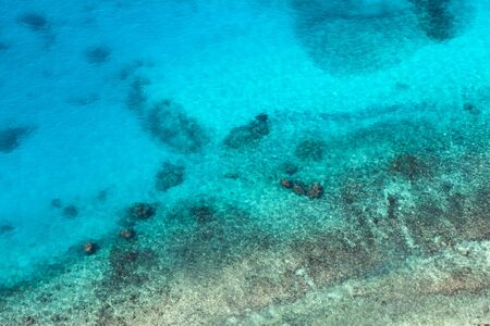 Persian Gulf, rocky seabed is under blue shallow water. Natural photo. Bird eye view 版權商用圖片