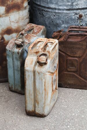 Old rusty German jerrycans for drinking water and gasoline from WWII period, vertical photo Standard-Bild
