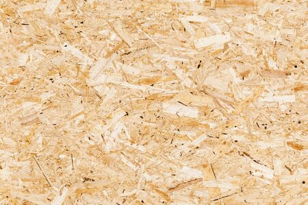 Wooden oriented strand board or OSB. Sterling board seamless background photo texture