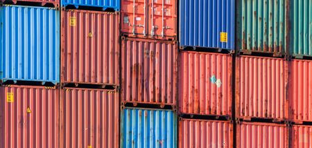 Stacked cargo containers, modern industrial shipping equipment background photo