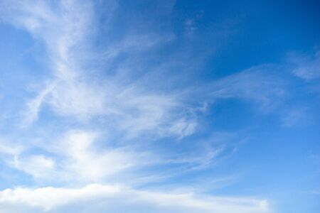 Blue sky with cirrus clouds at daytime. Natural background photo texture Standard-Bild