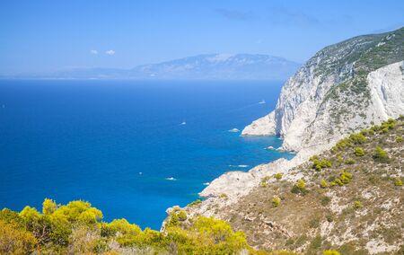 Navagio bay, Greece. Coastal landscape with rocks at sunny day, natural landmark of Greek island Zakynthos