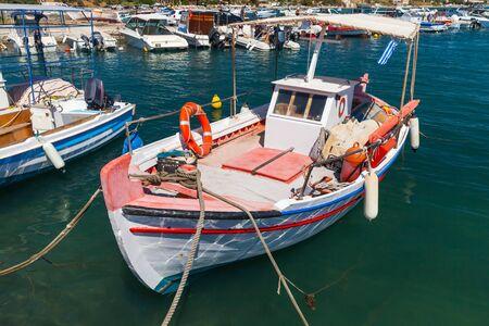 Wooden fishing boat is moored in port of Agios Sostis. Zakynthos, Greece