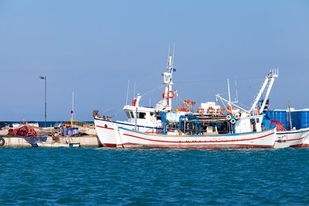 Fishing boats are moored in port of Zakynthos, Greece