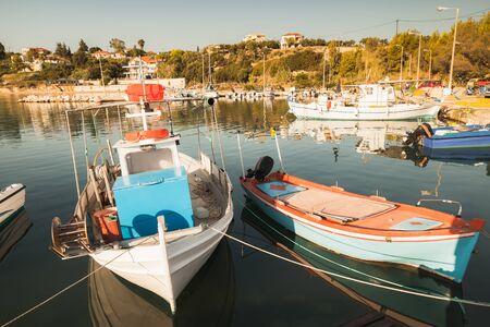 Wooden fishing boats moored in Tsilivi port. Zakynthos. Greece. Retro tonal correction filter Standard-Bild