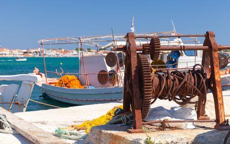 Rusty coastal winch for boats in port. Zakynthos, Greece