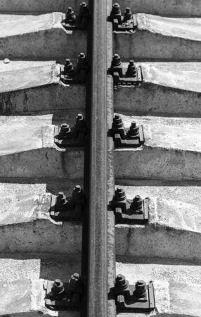 Rusty rail on concrete sleepers.