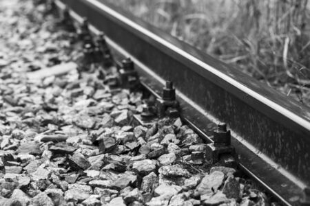 Railway track details, close-up black and white photo with selective focus and perspective effect Standard-Bild