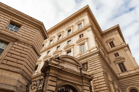 Rome, Italy - February 13, 2016: Exterior of the main office of the Italian National Bank in Rome. Classical architecture under cloudy sky