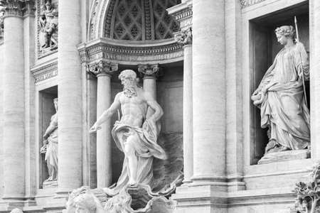 Rome, Italy - February 13, 2016: Sculptures of the Trevi Fountain. It is one of the most popular tourist attractions in Rome. Black and white photo Editorial