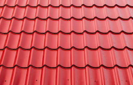 New red metal shingles roof texture, background photo Banco de Imagens