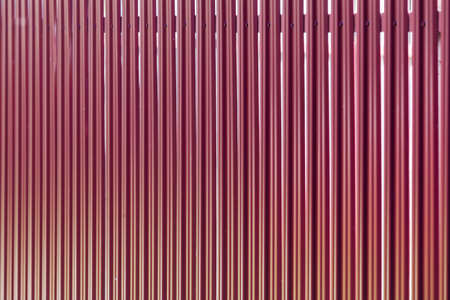 Outdoor fence made of red metal planks, abstract background photo with soft selective focus Banco de Imagens - 150971630