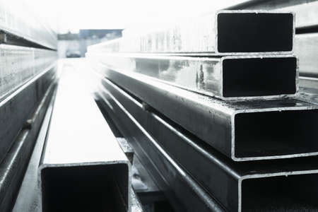 Stack of rolled metal products, perspective view of steel pipes of rectangular cross-section