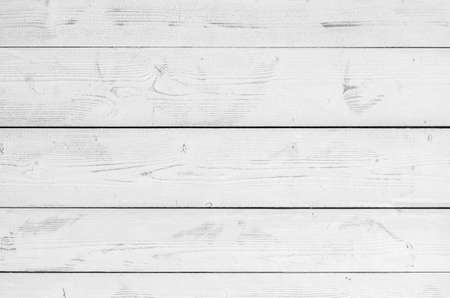 White wooden wall made of flat planks. Frontal background photo texture