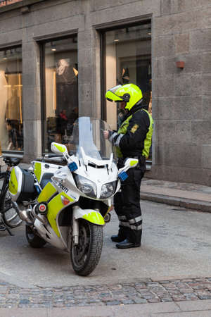 Copenhagen, Denmark - December 9, 2017: Motorcycle policeman is on a street of Copenhagen