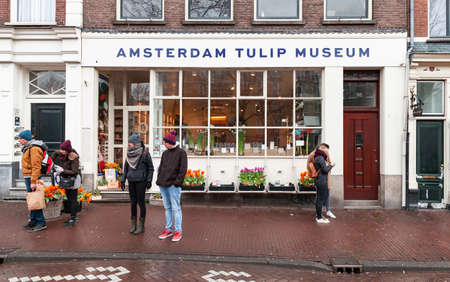Amsterdam, Netherlands - February 25, 2017: Tourists are near the entrance of the Amsterdam Tulip Museum