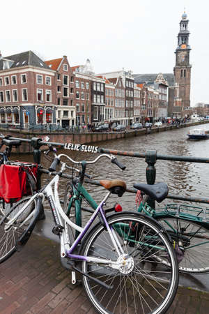 Amsterdam, Netherlands - February 25, 2017: Bicycles stand parked on the bridge in old Amsterdam