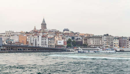 Istanbul, Turkey - June 28, 2016: Cityscape with Galata bridge and Beyoglu district, located at the northern part of the Golden Horn. Galata tower is on a background