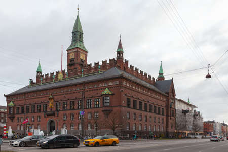 Copenhagen, Denmark - December 9, 2017: Street view with Copenhagen City Hall, cars and ordinary people are on the street