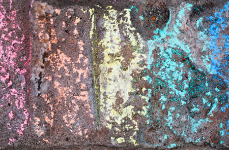 Chalk rainbow pattern over grunge concrete wall, abstract background texture