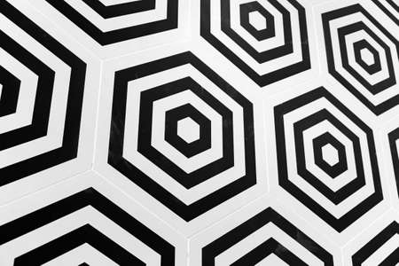 Decorative tiling, abstract black and white hexagonal geometric pattern, background texture