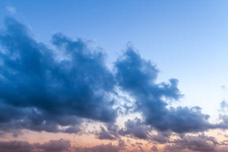 Dark clouds in the sky at sunset, natural background photo