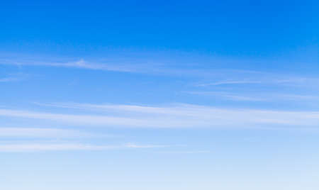 Blue sky with windy cirrus clouds at daytime, natural background photo texture