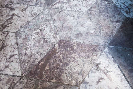 Grungy stone floor tiling with abstract cubic pattern, background photo texture