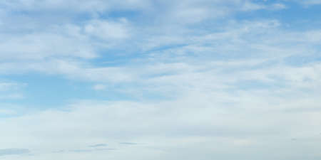Overcast blue sky at daytime, natural background photo texture