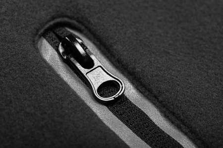 Zipper with reflectors of gray fleece jacket pocket, macro photo Imagens