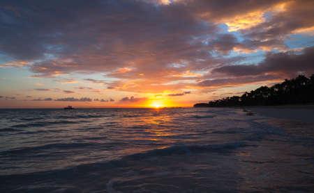 Colorful tropical landscape at sunrise. Atlantic Ocean coast, Bavaro beach, Punta Cana. Dominican Republic