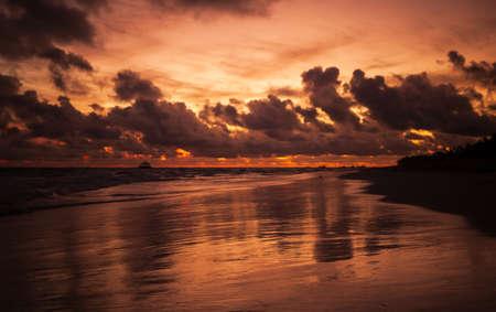 Sunrise over Atlantic Ocean coast, Bavaro beach, Dominican Republic. Dark empty coastal landscape Imagens