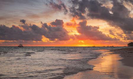 Colorful sunrise over Atlantic Ocean. Bavaro beach, Dominican Republic. Coastal morning landscape
