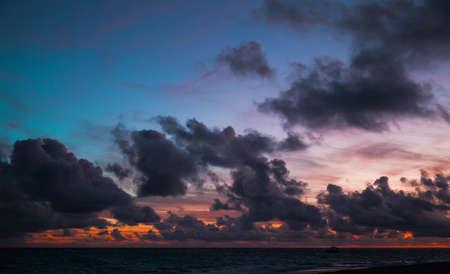 Night sky with dark clouds just before a sunrise. Atlantic Ocean coast, Bavaro beach, Dominican Republic Imagens