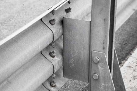 Gray metal guardrail construction mounted on a highway roadside