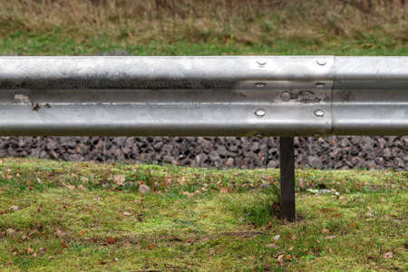 Metal guardrail mounted on a highway roadside