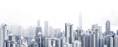 Blue toned modern cityscape background, panoramic city photo with urban skyline at foggy day Standard-Bild
