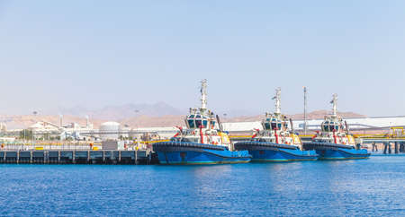 Tug boats are moored in Aqaba Port at sunny day, Jordan