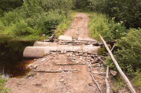 Empty rural road with damaged bridge, off-road transportation background photo 免版税图像