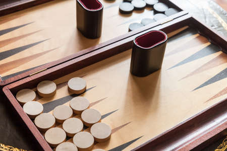 Vintage backgammon table game, clode-up photo with selective focus. This is the one of the oldest known board games