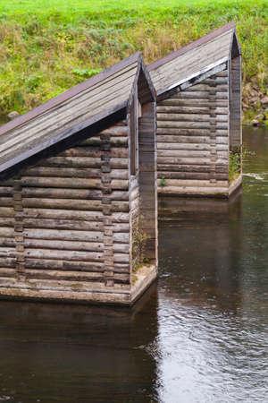 Structures of wooden lock of Tikhvinka river. Part of Tikhvinskaya water system. Vertical photo