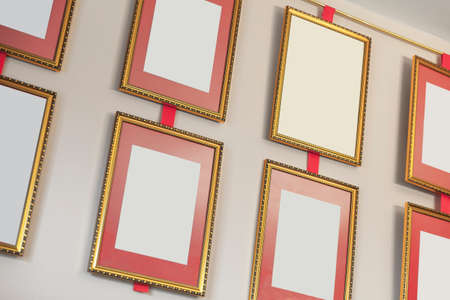 Empty golden frames are on the wall, background texture