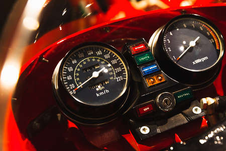 Sport bike dashboard with analog speedometer, tachometer, odometer and buttons