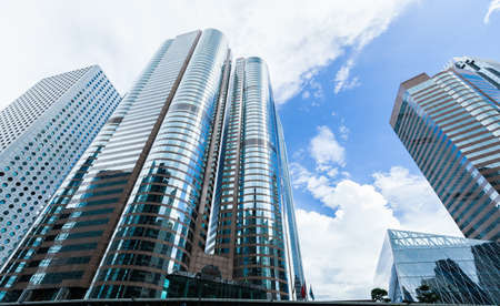 Urban skyline with perspective view of modern commercial skyscrapers, high-rise office buildings in Hong Kong city
