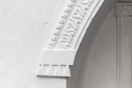 Abstract white architectural background with an arch in a wall. Ancient Russian temple facade decoration