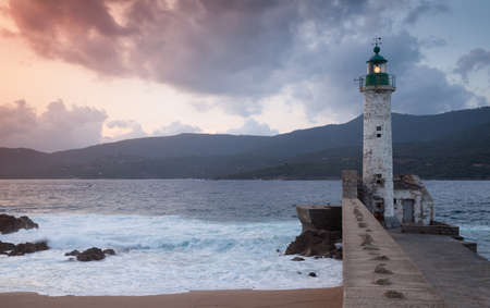 Lighthouse tower on a summer evening. Coastal landscape of Propriano, Corsica island, France